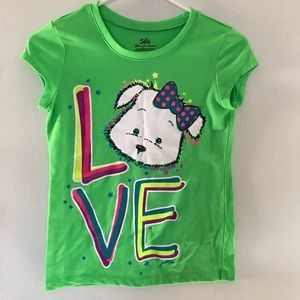 "Justice neon green ""LOVE"" shirt with a puppy"